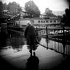 Old woman faces a rainy day in Paris. Paris, November 2013.