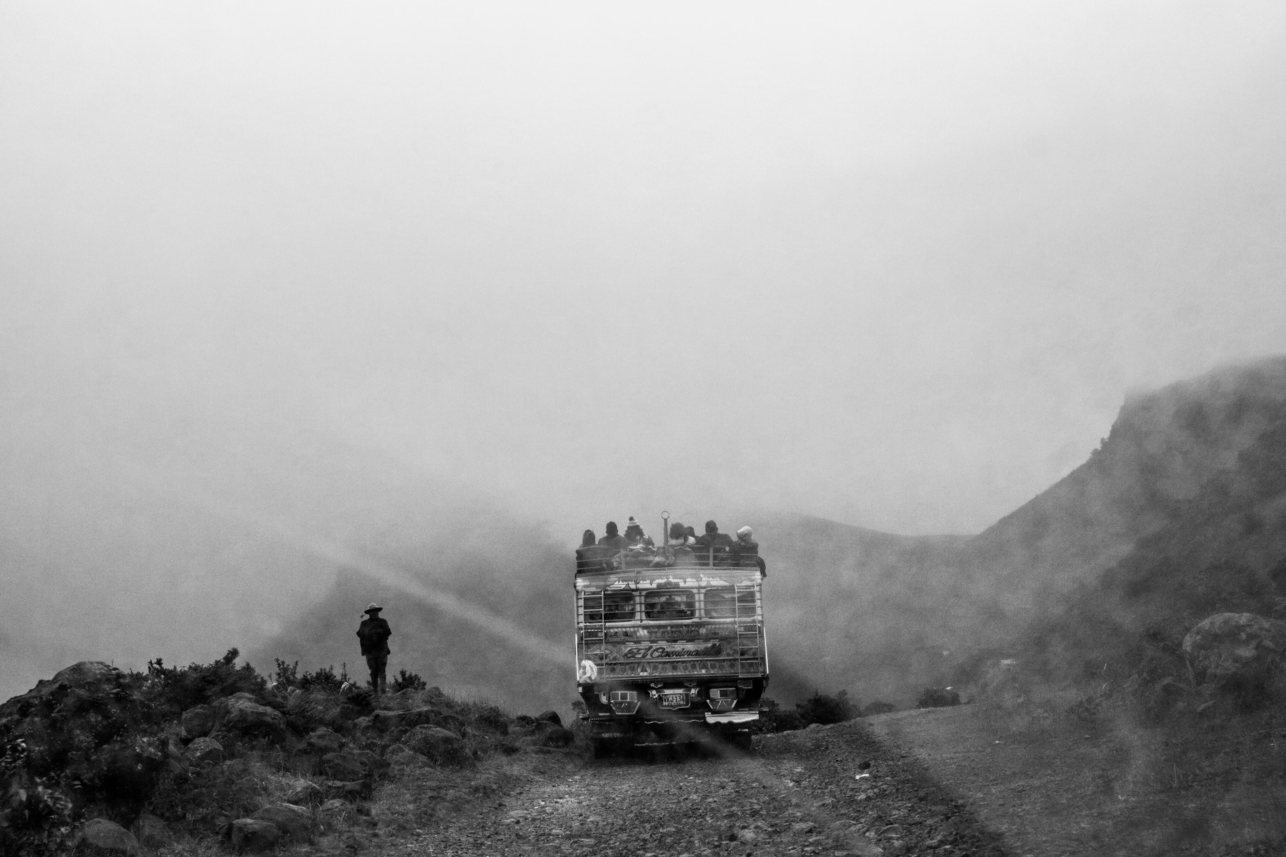 """Indigenous people from the Nasa reservation of Tacueyó arrive at the Páramo de Pisnos after a five hours long trip on a local 'chiva' (bus). They gather in this sacred place in order to celebrate the 'Khabu fxizehnxi' ('Refreshing of the Batons""""), one of the five main rituals of the Nasa indigenous people of the Cauca region in Colombia. Cauca region, Colombia, January 18th, 2019.2019."""