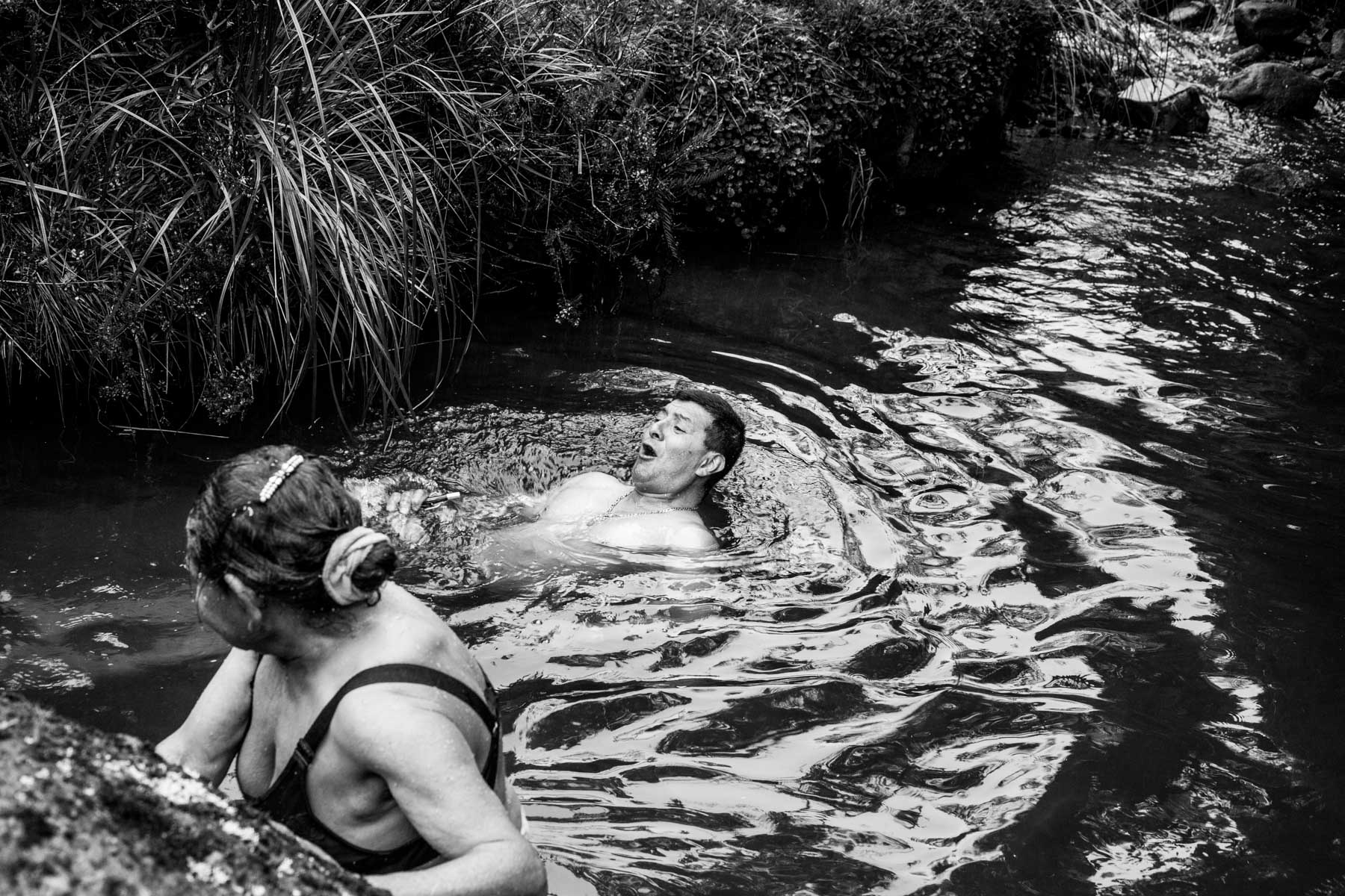 "Members of the Nasa indigenous community wash themselves in the icy waters of the Páramo de Pisnos as part of the cleansing ritual of the 'Khabu fxizehnxi' ('Refreshing of the Batons""), one of the five main rituals of the Nasa indigenous people of the Cauca region in Colombia. Cauca region, Colombia, January 2019."