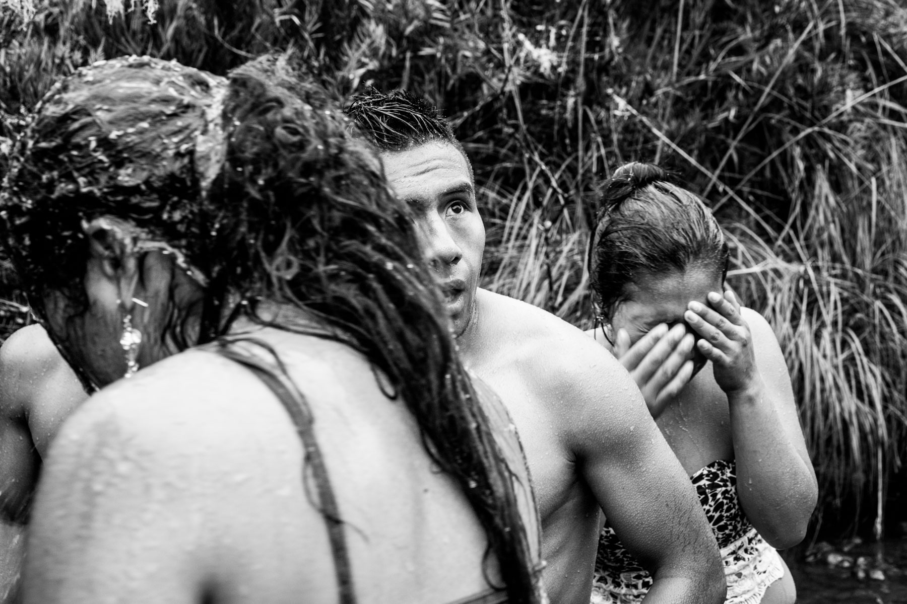 "Young members of the Nasa indigenous community get out from the icy waters of the Páramo de Pisnos after washing themselves as part of the cleansing ritual of the 'Khabu fxizehnxi' ('Refreshing of the Batons""), one of the five main rituals of the Nasa indigenous people of the Cauca region in Colombia. Cauca region, Colombia, January 2019."